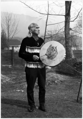 Hon. Chief Dan George, Burrard Reserve [Tsleil-Waututh], North Vancouver with drum painted by Min...