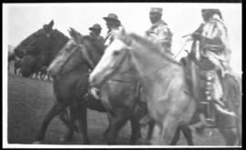 View of four men on horseback