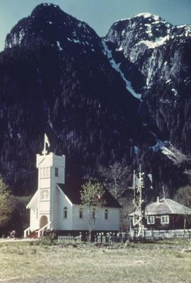 Christian church at base of steep mountain