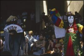 Masked dancers with audience