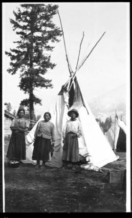 Portrait of three women and tipi