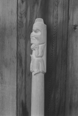 [Side profile of carving]