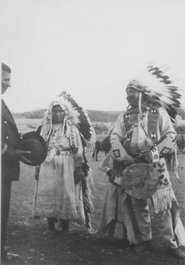Chief Jacob Chiniki with his wife making a presentation to the Governor General