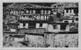View of houses built against a hillside