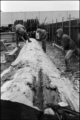 Crew working on log at the Turnbull & Gail construction yard in Richmond (contractors for bui...
