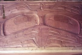 Wood relief carving with eyes