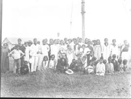 Group portrait in front of a pole