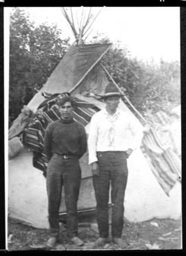 Portrait of two men in front of tipi