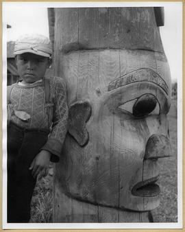 Child and totem pole