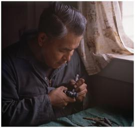People (Haida) [man carving]