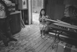 [Joe David's daughter inside carving hut]