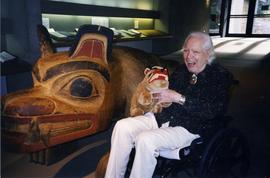 [Bill Reid with stuffed toy and artwork]