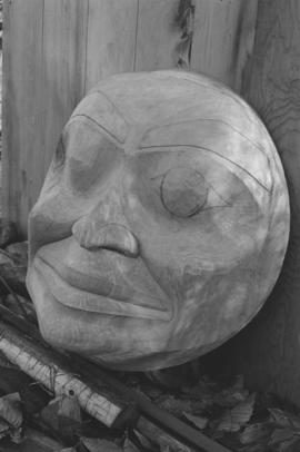 [Close-up of large carving of face]