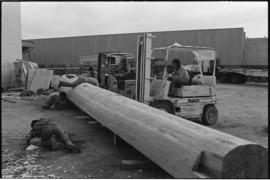 Crew moving log from the Turnbull & Gail construction yard in Richmond (contractors for build...