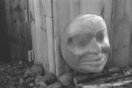 [Large carving of a face]