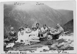 Nine people reclining outdoors