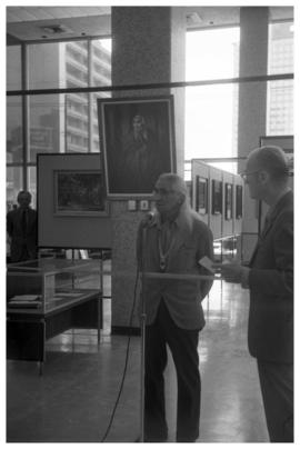 Chief Dan George, Centennial opening of display, Vancouver Public Library with painting of Dan Ge...