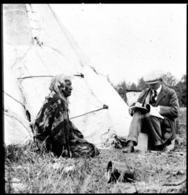 Portrait of two men in front of tipi, view two