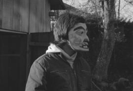 [Profile of unidentified person wearing mask]