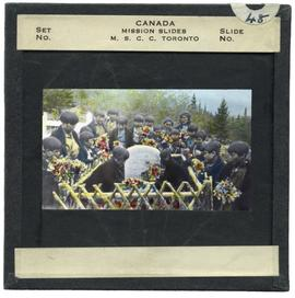 People at Bompas Grave in Carcross