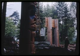 Bill Reid watching the construction of the Haida house
