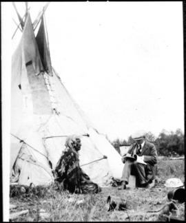 Portrait of two men in front of tipi, view one