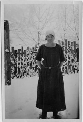 A woman standing in the snow