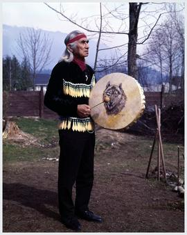 Ole Antoine,' Dan George, Burrard Reserve, North Vancouver holding a drum painted by Minn Sjoselth