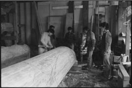 Crew and log at the old UBC carving shed