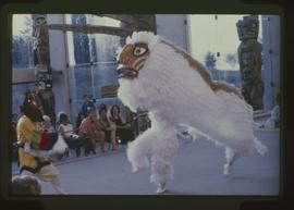 Dancer with sword and lion dancers