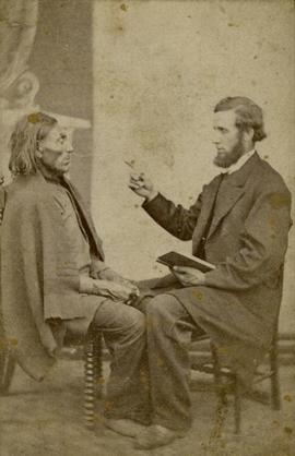 Portrait of Crosby seated with another man