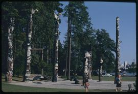 Totem poles and Vancouver sky line, Stanley Park, Vancouver, B.C.