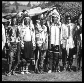 Group portrait of men in native clothing, view two