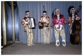 [Dan George & band in traditional clothing]