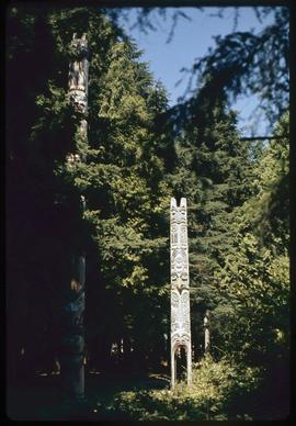 Totem Park, UBC, Vancouver, Kwakiutl (#2 + 5 carved by Mungo Martin), Alert Bay sea lion pole #2,...