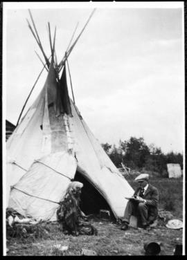Portrait of two men in front of tipi, view three
