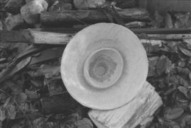[Close-up of hat on firewood]