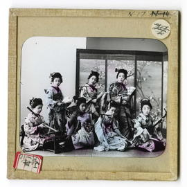 Group of young women (Geisha?) with musical instruments and fans