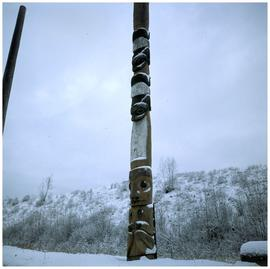 Two totem poles in snow