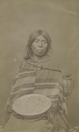 [Indian woman with harvest bowl, Fraser River, B. C.]