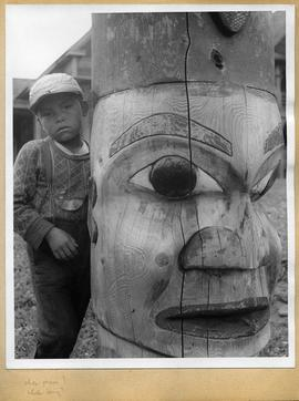 Child and totem pole, view two