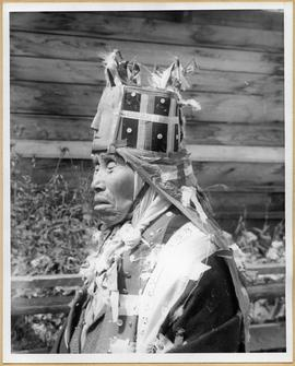 Profile view of man in ceremonial dress