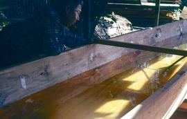 Carving a canoe