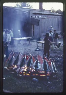 Salmon on the fire outside Haida House