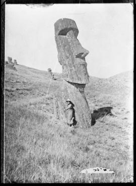 Young girl in front of a moai